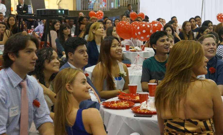 Greenwich High seniors in the AVID class of 2015 watch a slideshow of their time at the high school, during the recognition ceremony in the Greenwich High student center on Wednesday, June 3, 2015. Photo: Paul Schott / Greenwich Time