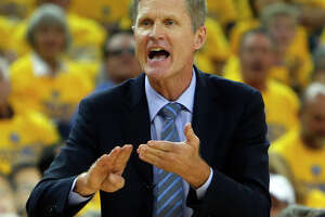 Strikingly different paths of coaches both lead NBA Finals - Photo