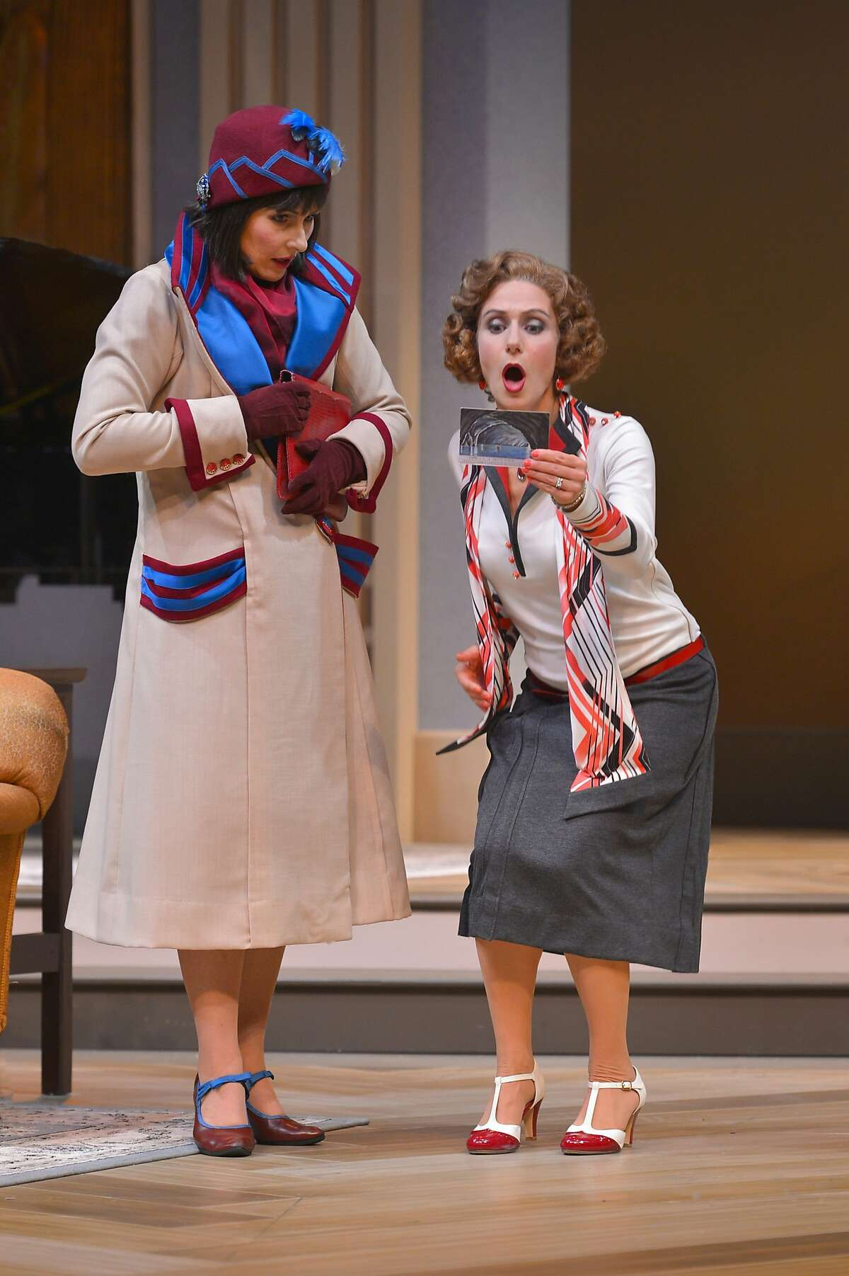 """Disaffected wives Jane (Rebecca Dines, left) and Julia (Sarah Overman) receive a postcard from former mutual lover Maurice while their husbands are out of town in """"Fallen Angels"""" at TheatreWorks"""