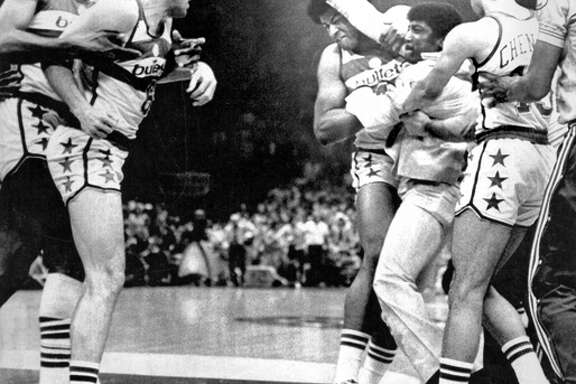 Golden State Warriors vs the Washington Bullets Playoffs 5/25/1975 NBA Championship Coach Al Attles is restrained by (l to r) Wes Unseld and Phil Chenier objecting the Bullets rough play. He was ejected from the game AP photo