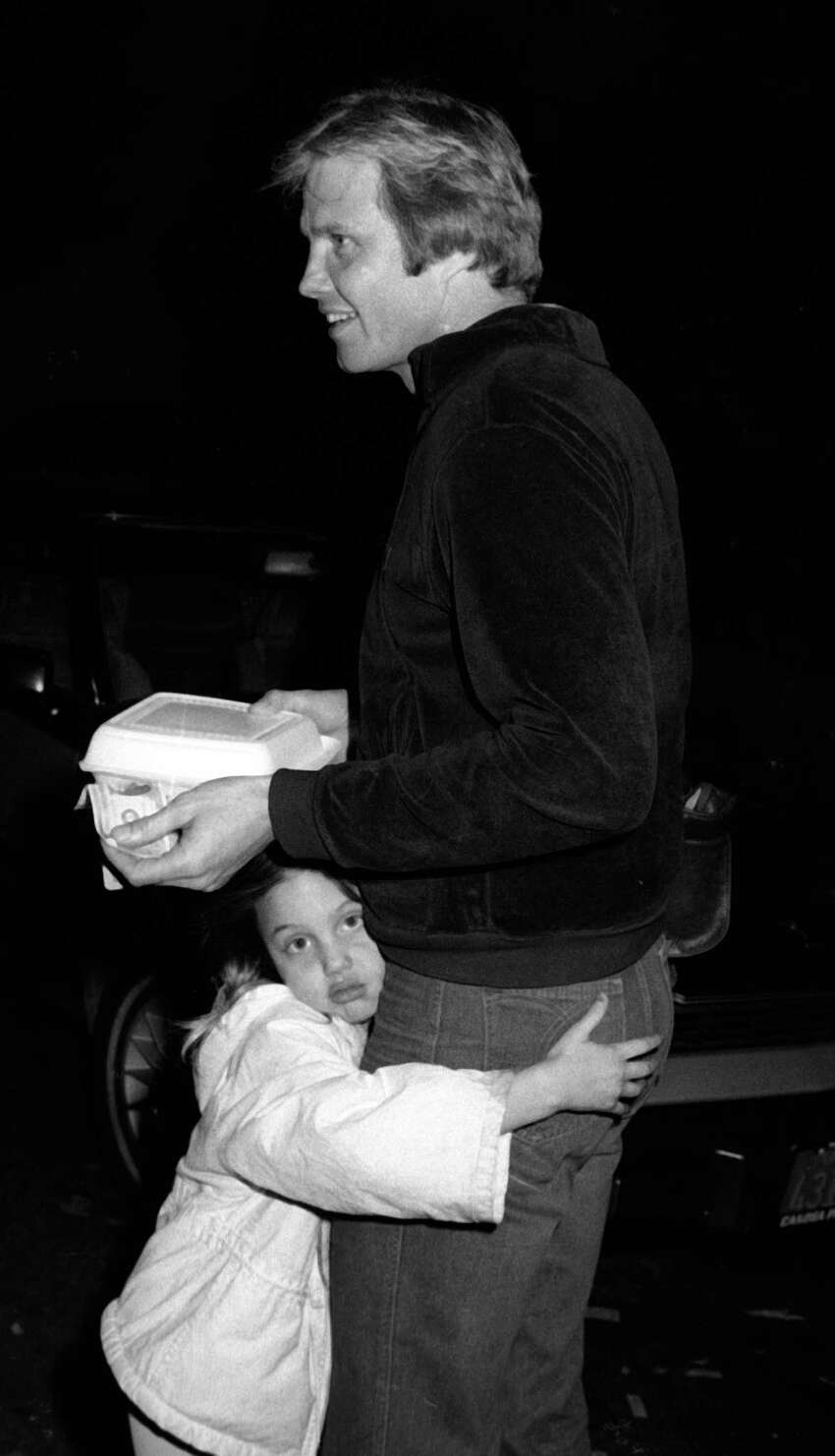 Jon Voight and Angelina Jolie, then just 5, sighted on January 8, 1981 in Beverly Hills, California.