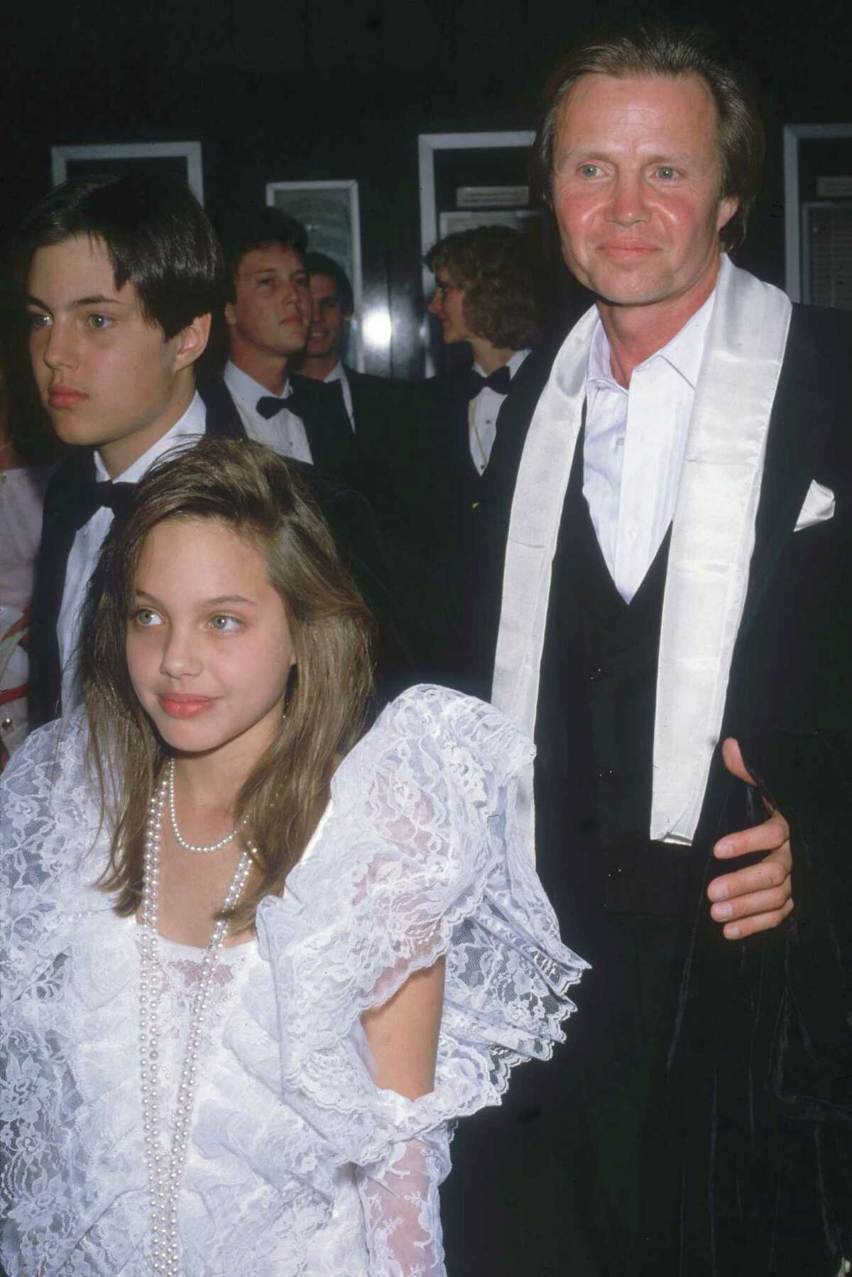 Jon Voight attends the Academy Awards with his son James Haven Voight (left) and daughter Angelina Jolie Voight, then 10 years old, in Los Angeles, March 24, 1986.