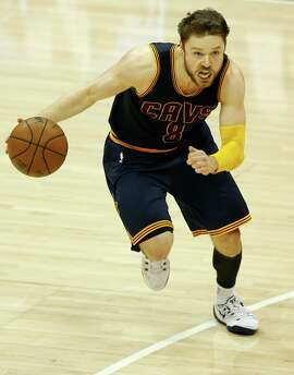 ATLANTA, GA - MAY 22: Guard Matthew Dellavedova #8 of the Cleveland Cavaliers dribbles in Game Two of the Eastern Conference Finals against the Atlanta Hawks during the 2015 NBA Playoffs at Philips Arena on May 22, 2015 in Atlanta, Georgia. NOTE TO USER: User expressly acknowledges and agrees that, by downloading and or using this photograph, user is consenting to the terms and conditions of the Getty Images Licensing Agreement. Mandatory Copyright Notice: Copyright 2011 NBAE (Photo by Mike Zarrilli/Getty Images)