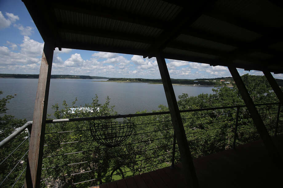 This is the view from the deck of a multi-story house on the shore of Medina Lake in Lakehills, Texas and is under contract Tuesday June 2, 2015 and will fetch a price of about $649,000 according to Michelle Reichle of Hi Energy Realty. Now that more water is in the lake, speculators may be considering lakefront property as an investment or just a good buy. Photo: John Davenport, Staff / San Antonio Express-News / ©San Antonio Express-News/John Davenport