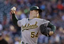 Oakland Athletics starting pitcher Sonny Gray throws during the first inning of a baseball game against the Detroit Tigers, Wednesday, June 3, 2015, in Detroit. (AP Photo/Carlos Osorio)
