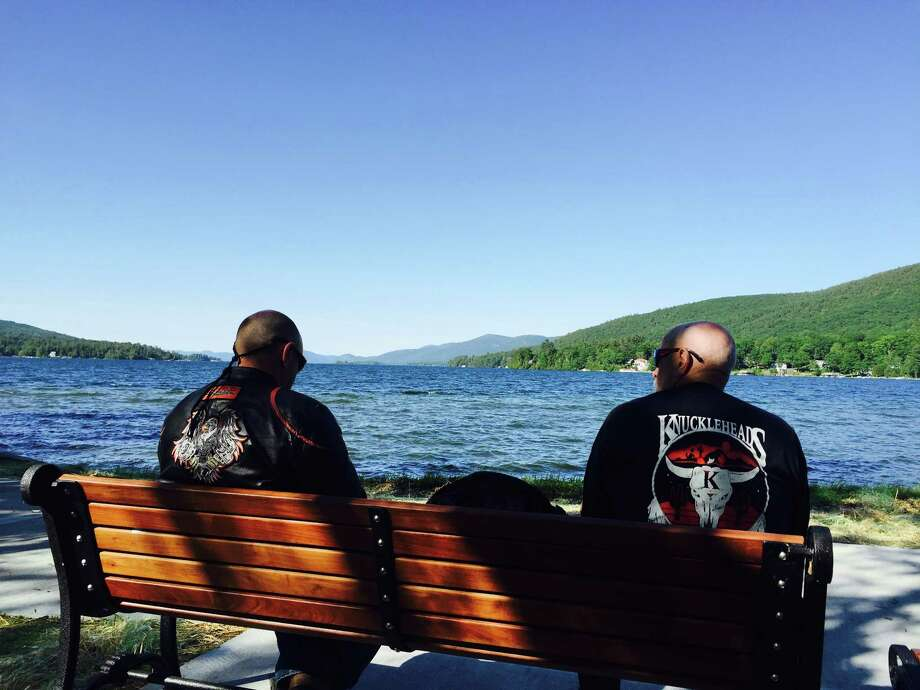 Motorcyclists look over Lake George during a break in Wednesday's Americade events. (Keshia Clukey / Time Union)