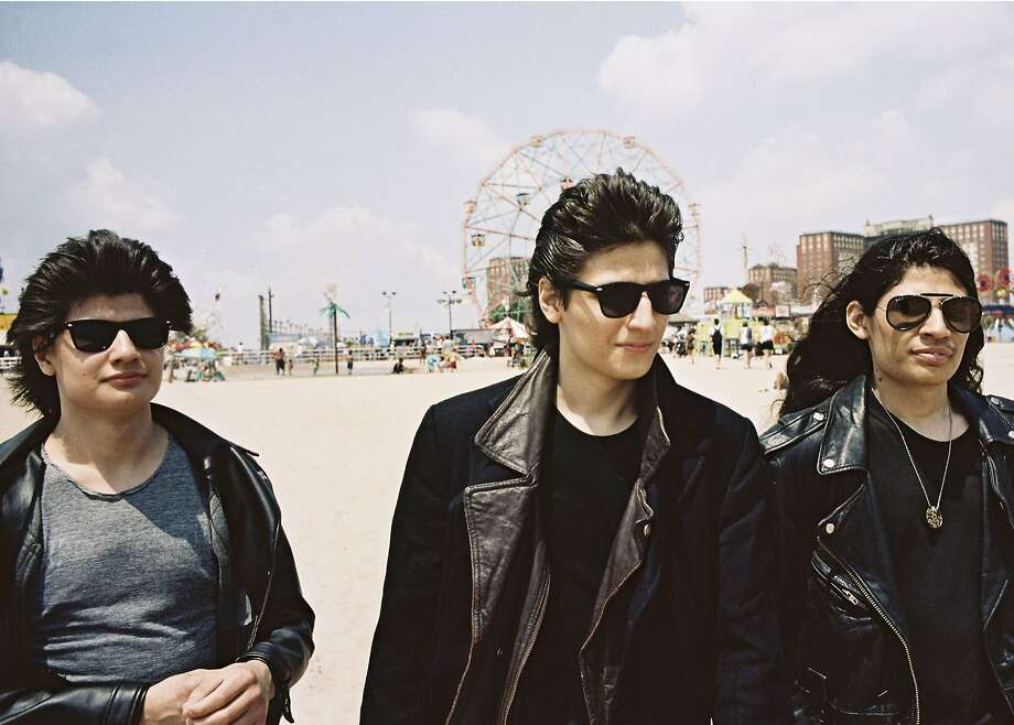 """Krsna, Jagadisa and Mukunda are three of six brothers savoring freedom after years of being kept inside by their father. Their story is told in """"The Wolfpack."""" Photo: Magnolia Pictures"""