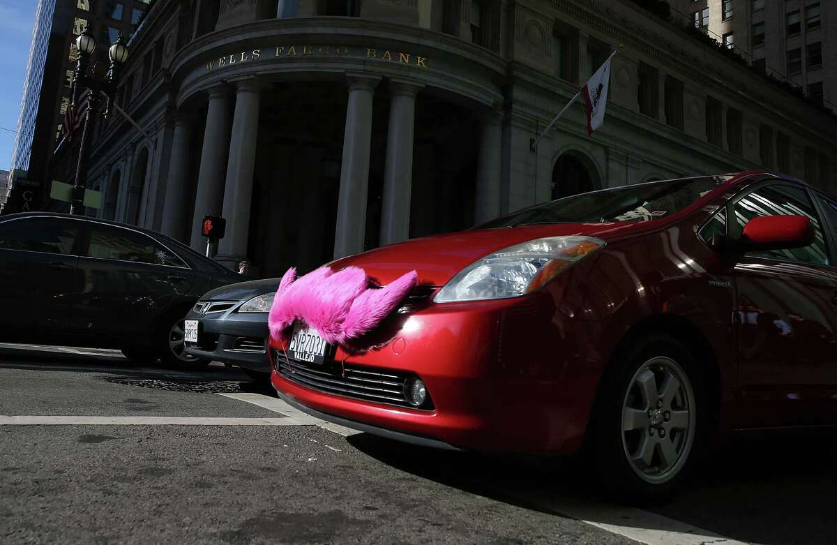A Lyft car in San Francisco last year sports the company's original furry mustache, since replaced by a smaller version on dashboards. Allstate will offer Ride for Hire insurance to cover drivers on their way to pick up passengers.