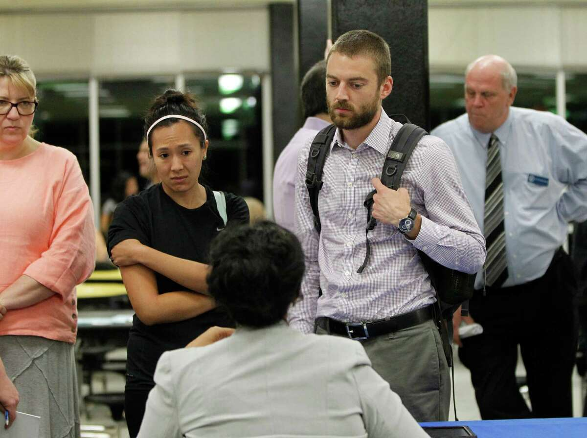 Officials speak with flood victims at a public meeting held at Fondren Middle School on June 3.