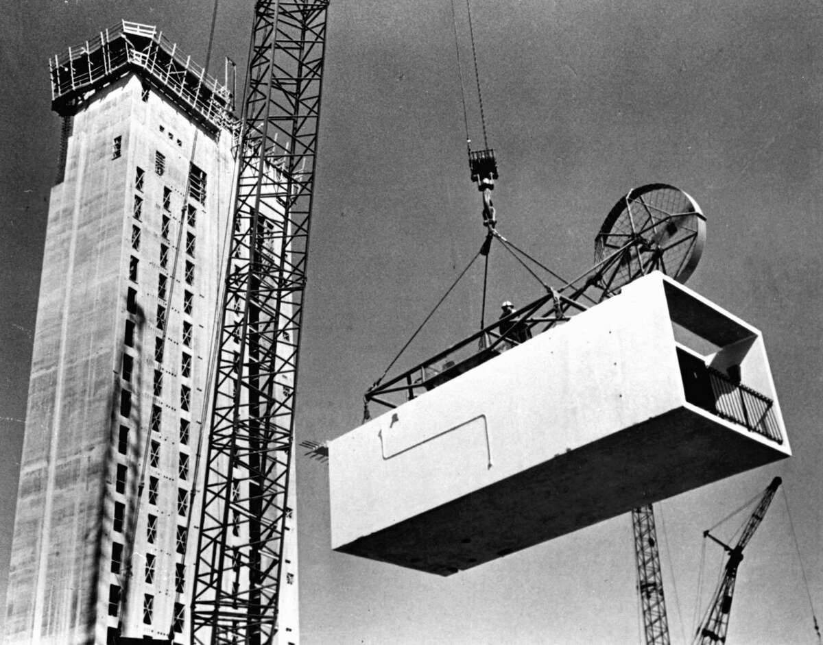 Crews lift a prefabricated room to stack it onto the Hilton Palacio del Rio on the River Walk in 1967.