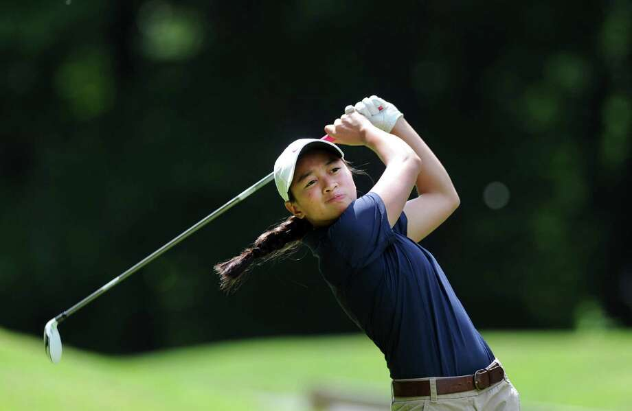 Staples' Anelise Brown tees off Wednesday, June 4, 2014, during the FCIAC Girl's Golf Championship at Fairchild Wheeler Golf Course in Fairfield, Conn. Photo: Autumn Driscoll / Autumn Driscoll / Connecticut Post