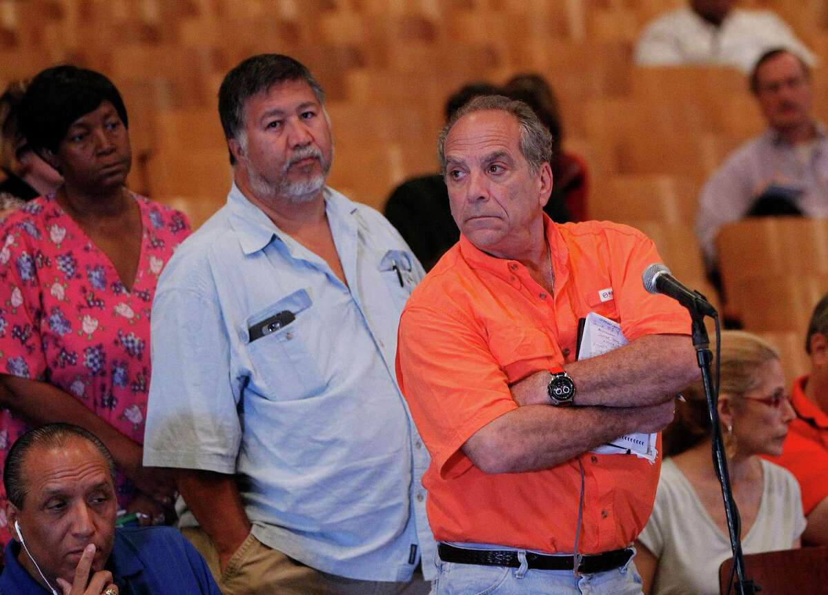Alan Kirshner, right, said his Meyerland home had 42 inches of water and he lost four cars. He said the city wasn't doing enough about drainage.