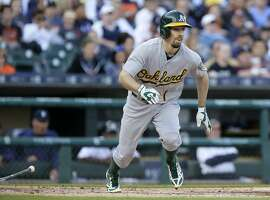 DETROIT, MI - JUNE 3: Billy Burns #1 of the Oakland Athletics watches his three-run triple against the Detroit Tigers during the second inning at Comerica Park on June 3, 2015 in Detroit, Michigan. (Photo by Duane Burleson/Getty Images)