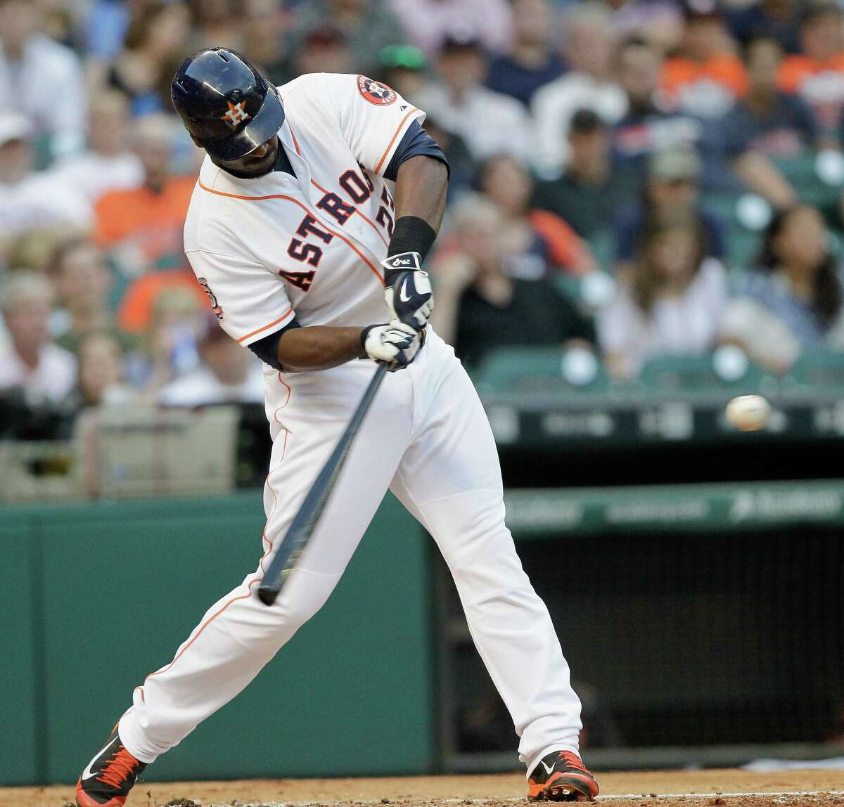 Chris Carter's swing creates the lift that sent the ball flying out of the park in the second inning, the first of his two bases-empty home runs.