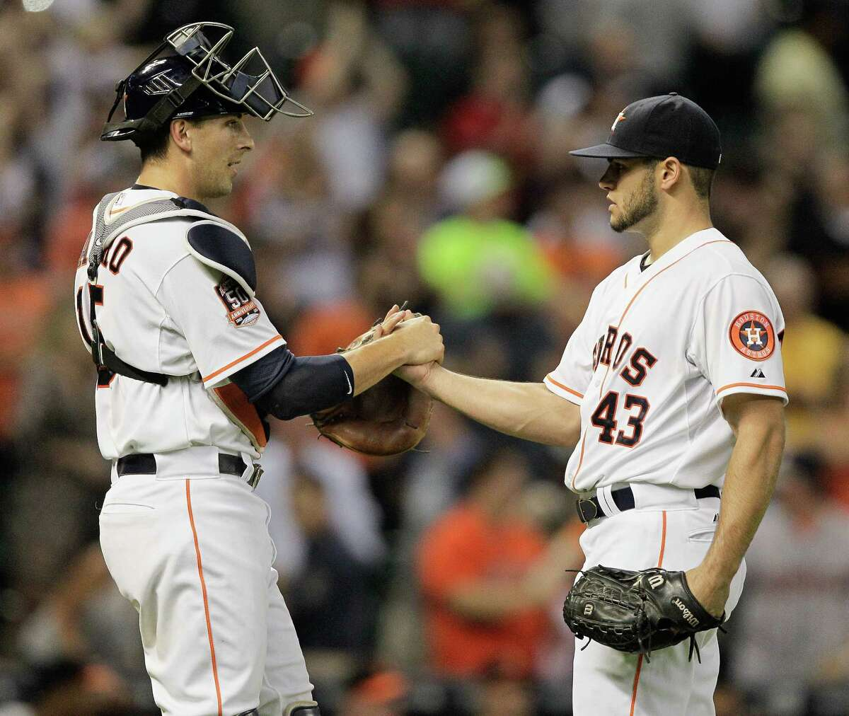 Astros rookie righthander Lance McCullers, right, receives congratulations for his first complete-game performance since his high school days from catcher Jason Castro on Wednesday night at Minute Maid Park.
