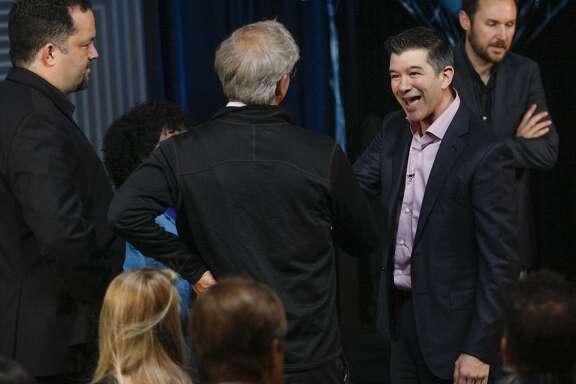CEO Travis Kalanick, second from right, chats with colleagues and friends before his speech, Wednesday, June 3, 2015, at the Uber headquarters in San Francisco, Calif. Kalanick gave a speech at Uber's five-year anniversary event.