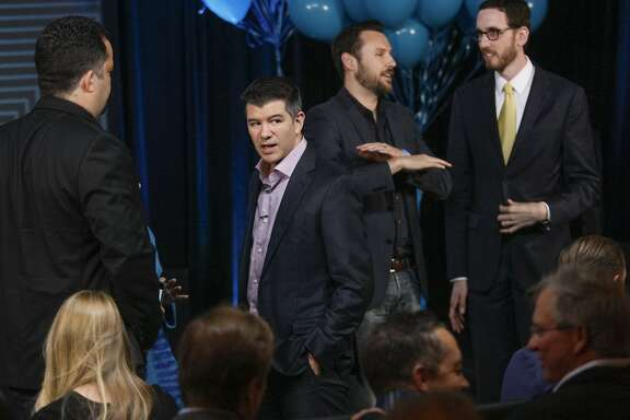 CEO Travis Kalanick, second from left, chats with colleagues and friends before his speech, Wednesday, June 3, 2015, at the Uber headquarters in San Francisco, Calif. Kalanick gave a speech at Uber's five-year anniversary event.