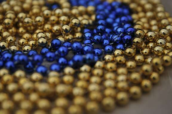 Blue and gold bead necklaces for guests at the Warriors pre-NBA Finals party at the Lake Chalet on Lake Merritt  in Oakland, Calif., on Wednesday, June 3, 2015. The Warriors play the Cleveland Cavaliers in the 2015 NBA Finals beginning Thursday.