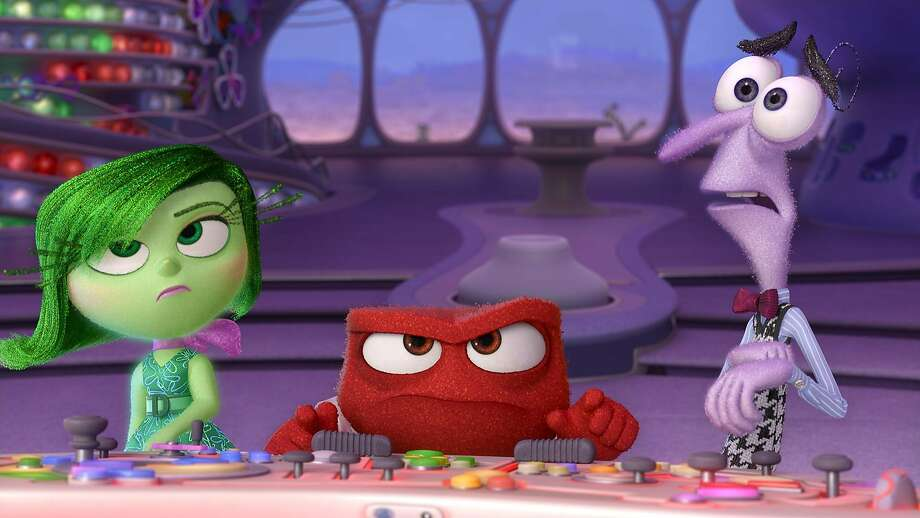 """Disgust, Anger and Fear (voiced by Mindy Kalin, Lewis Black and Bill Hader) are among the conflicting emotions inside a girl's mind in """"Inside Out."""" Photo: Handout, Washington Post"""