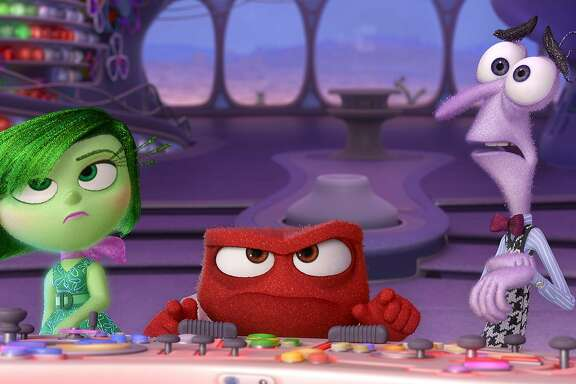 """Disgust, Anger and Fear (voiced by Mindy Kalin, Lewis Black and Bill Hader) are among the conflicting emotions inside a girl's mind in the Pixar feature """"Inside Out."""" Illustrates KIDSPOST-MOVIES (category l), by Christina Barron, (c) 2015, The Washington Post. Moved Tuesday, June 02, 2015. (MUST CREDIT: Pixar.)"""