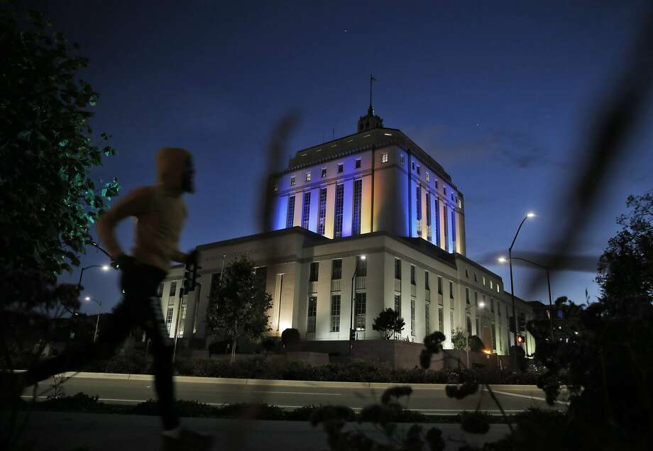 The Alameda County Court is lighted with the colors of the Golden State Warriors in anticipation of the NBA Finals in Oakland, Calif., on Wednesday, June 3, 2015. The Warriors play the Cleveland Cavaliers in the 2015 NBA Finals beginning Thursday. Photo: Carlos Avila Gonzalez, The Chronicle