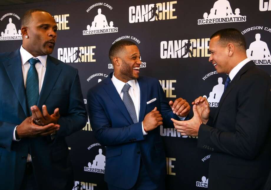 From left, New York Yankees pitcher CC Sabathia, Mariners player Robinson Cano and Yankees player Alex Rodriguez have fun during Robinson Cano's Latin-themed supper club fundraiser, Canoche, at the Paramount Theatre on Wednesday, June 3, 2015. The event was a fundraiser for Cano's RC22 foundation. (Joshua Trujillo, seattlepi.com) Photo: SEATTLEPI.COM