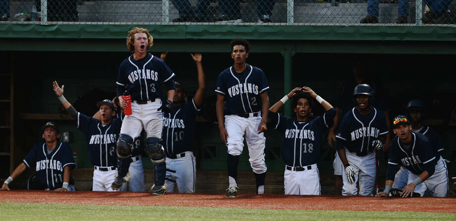 The West Orange-Stark bench comes alive in protest over an umpire's call during Wednesday's game against Huffman Hargrave. The West Orange-Stark Mustangs took on the Huffman Hargrave Falcons at Vincent-Beck Stadium on Wednesday.  Photo taken Wednesday 6/3/15  Jake Daniels/The Enterprise Photo: Jake Daniels / ©2015 The Beaumont Enterprise/Jake Daniels