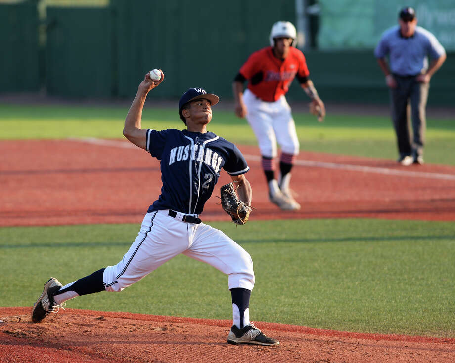 The Mustangs' Grant Anderson, No. 2, throws against a Falcons hitter Wednesday. The West Orange-Stark Mustangs took on the Huffman Hargrave Falcons at Vincent-Beck Stadium on Wednesday. Photo taken Wednesday 6/3/15 Jake Daniels/The Enterprise Photo: Jake Daniels / ©2015 The Beaumont Enterprise/Jake Daniels