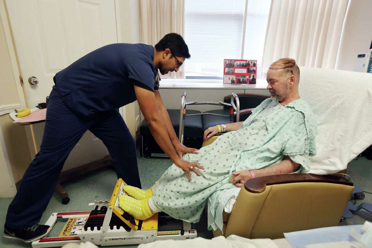 (left to right)Physical Therapist TechnicianRegi Mathew works with transplant patient Jim Boysen at Houston Methodist Hospital on Wednesday, June 3, 2015, in Houston. Surgeons from Houston Methodist Hospital and MD Anderson Cancer Center performed the world's first skull and scalp transplant on May 22.