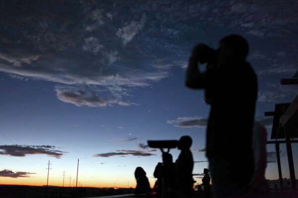 People look for the Marfa Lights at the Marfa Lights Viewing Area, nine miles east of Marfa, Texas.