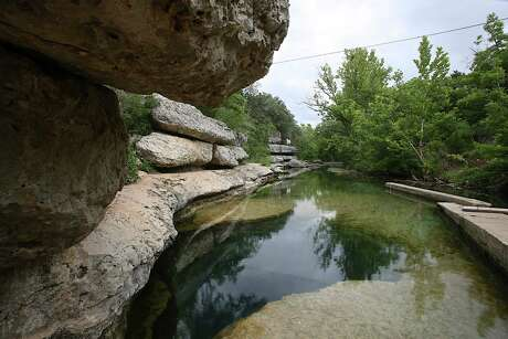 Jacob's Well is a swimming-hole tradition in Wimberley. This year, visitors must reserve a time in advance to swim.
