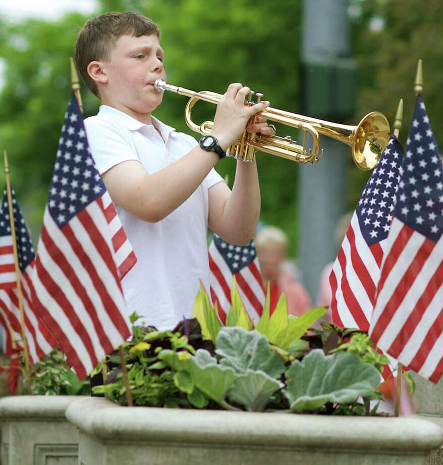 "Jules Manes ably performs ""Taps"" at the foot of the war memorial in the Kent village center during the town's Memorial Day parade and ceremonies. May 25, 2015 Photo: Trish Haldin / The News-Times Freelance"
