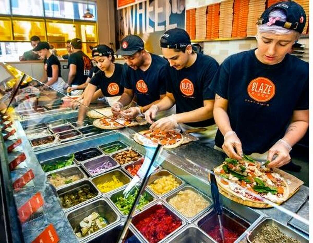 Blaze Pizza, with its build-your-own concept, is opening two Houston-area restaurants in summer 2015. (Blaze Pizza)