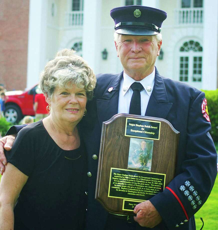 Harry Wright, shown with his wife, Darby, is the 2015 recipient of the Major Stephen Reich Award of Exceptional Citizenship, presented each Memorial Day in Washington to a resident for his or her contributions to the community. The award is given in memory of Major Reich, who graduated from Shepaug Valley High School and the United States Military Academy at West Point, and died in 2005 in  Afghanistan while serving with the U.S. Army Special Forces. May 25, 2015 Photo: Trish Haldin / The News-Times Freelance