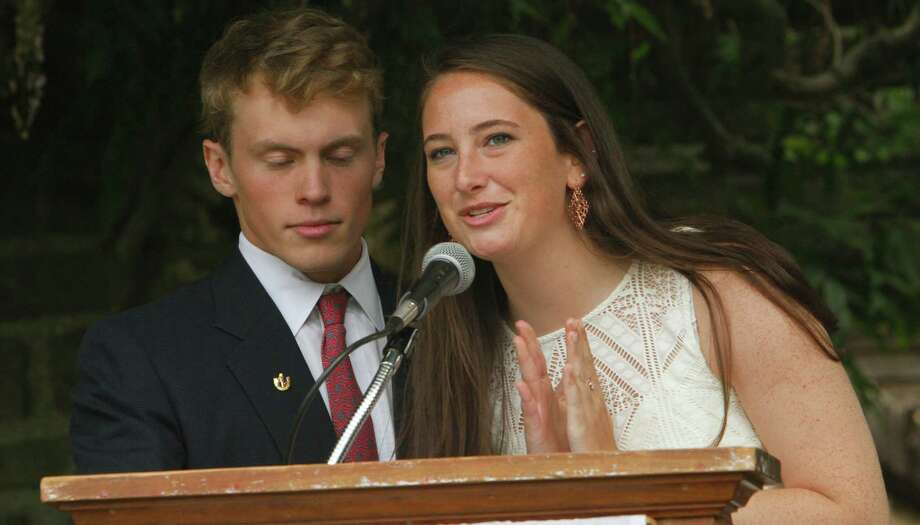 From left,Class President Martin Brennan and Student Council Chair Claire Comey present the Senior Class gift during commencement exercises at Greens Farms Academy in Westport, Conn. on Thursday, June 4, 2015. Photo: Matthew Brown / Connecticut Post Freelance