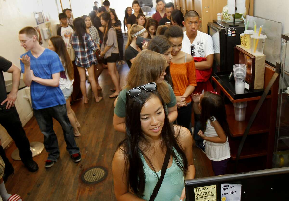 Inside Tpumps the mostly young crowd waits patiently for their tea. Tpumps is a local bubble tea shop, which has been using a customer loyalty program developed by a San Francisco startup called FiveStars. Their location in downtown San Mateo Monday April 29, 2013 has a line out the door.