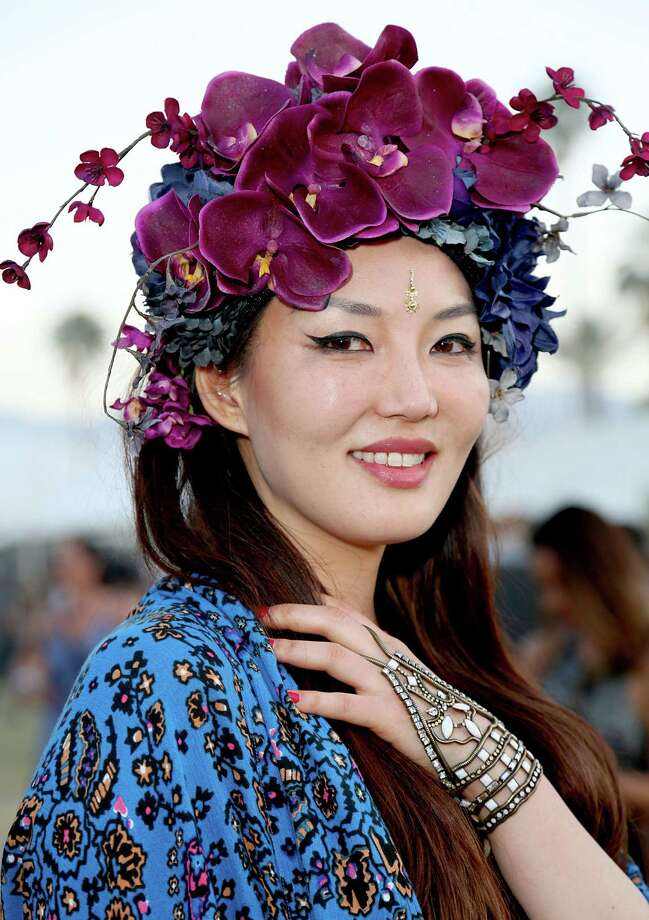 INDIO, CA - APRIL 11:  Festival attendee Catherine Ahn wearing a Ms G designs floral headdress during the 2015 Coachella Valley Music and Arts Festival - Weekend 1 at The Empire Polo Club on April 11, 2015 in Indio, California.  (Photo by Rachel Murray/Getty Images for Coachella) Photo: Rachel Murray, Stringer / 2015 Getty Images