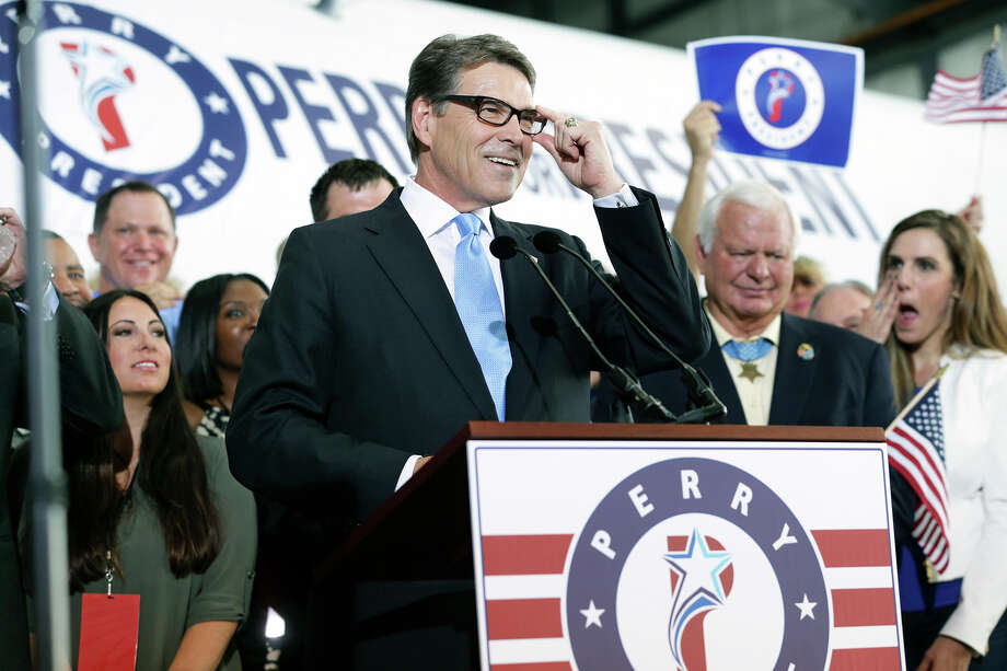 Former Texas Governor Rick Perry announces his candidacy  for President of the United States at the Million Air hanger at the Addison airport near Dallas on June 4,, 2015. Photo: Tom Reel / San Antonio Express-News