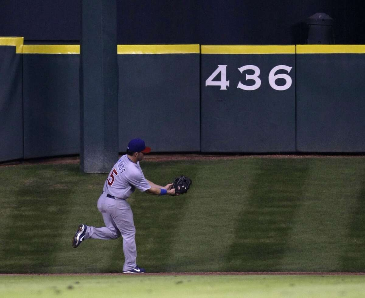 Jim Edmonds catches a ball hit by Hunter Pence on Tal's Hill during the 4th inning of the Houston Astros-Chicago Cubs MLB baseball game at Minute Maid Park, Monday, May 19, 2008, in Houston. ( Karen Warren / Chronicle )