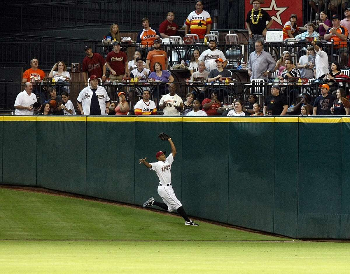 Houston Astros center fielder Justin Maxwell (44) stumbles down Tal's Hill trying to catch a ball hit by Pittsburgh Pirates right fielder Garrett Jones (46) in the first inning as the Houston Astros lost to the Pittsburgh Pirates 4-3 in a Major League Baseball game at Minute Maid Park Saturday, July 28, 2012, in Houston. ( Johnny Hanson / Houston Chronicle )