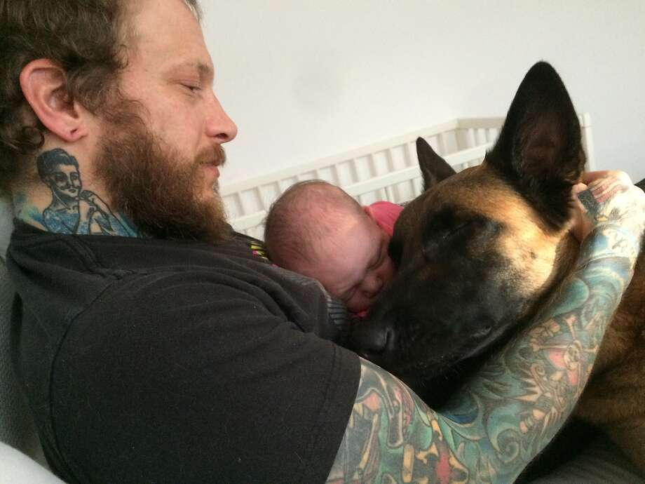 """This is a photo of Ari Sonnenberg with his daughter, Nila Louise Sonnenberg, born April 1, 2015, and his dog, Sigmund Freud or Siggy. Siggy is a Belgian Mallinois. Here is what Patty Snijders (Ari's wife) says: """"The dog has helped both Ari and me tremendously. He's made our marriage stronger and prepared us for parenthood in many ways."""" Photo: Patty Snijders"""