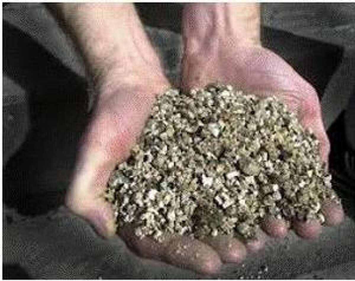 Vermiculite is grayish and pebble-like in texture.