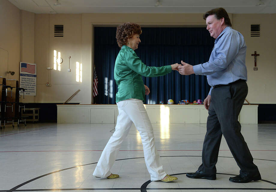 Freddie Costlow and Rick Eddie partner up as they learn new steps during the second meeting of the West Coast Swing dance lessons Wednesday night in the cafeteria at St. Anne's Catholic School in Beaumont. The six-week session is being led by instructors with the Round Abouts dance club. Individuals and couples can still sign up for the classes by contacting Gloria Jackson at 409-313-6151. Photo taken Wednesday, June 3, 2015 Kim Brent/The Enterprise Photo: Kim Brent / Beaumont Enterprise