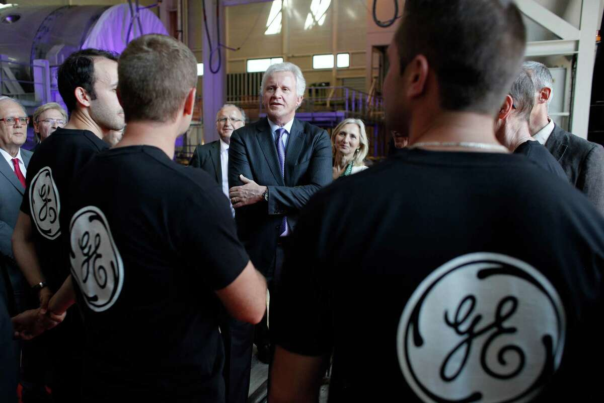 General Electric CEO Jeffrey R. Immelt, center, speaks with workers as he visits the GE plant in Belfort, eastern France.