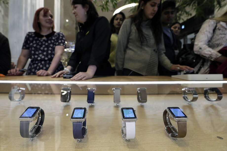 Apple Watches are on display in a store in London in April. The company says it should fill most of its orders and have enough to sell directly to shoppers in the Apple Stores. Photo: Tim Ireland, Associated Press
