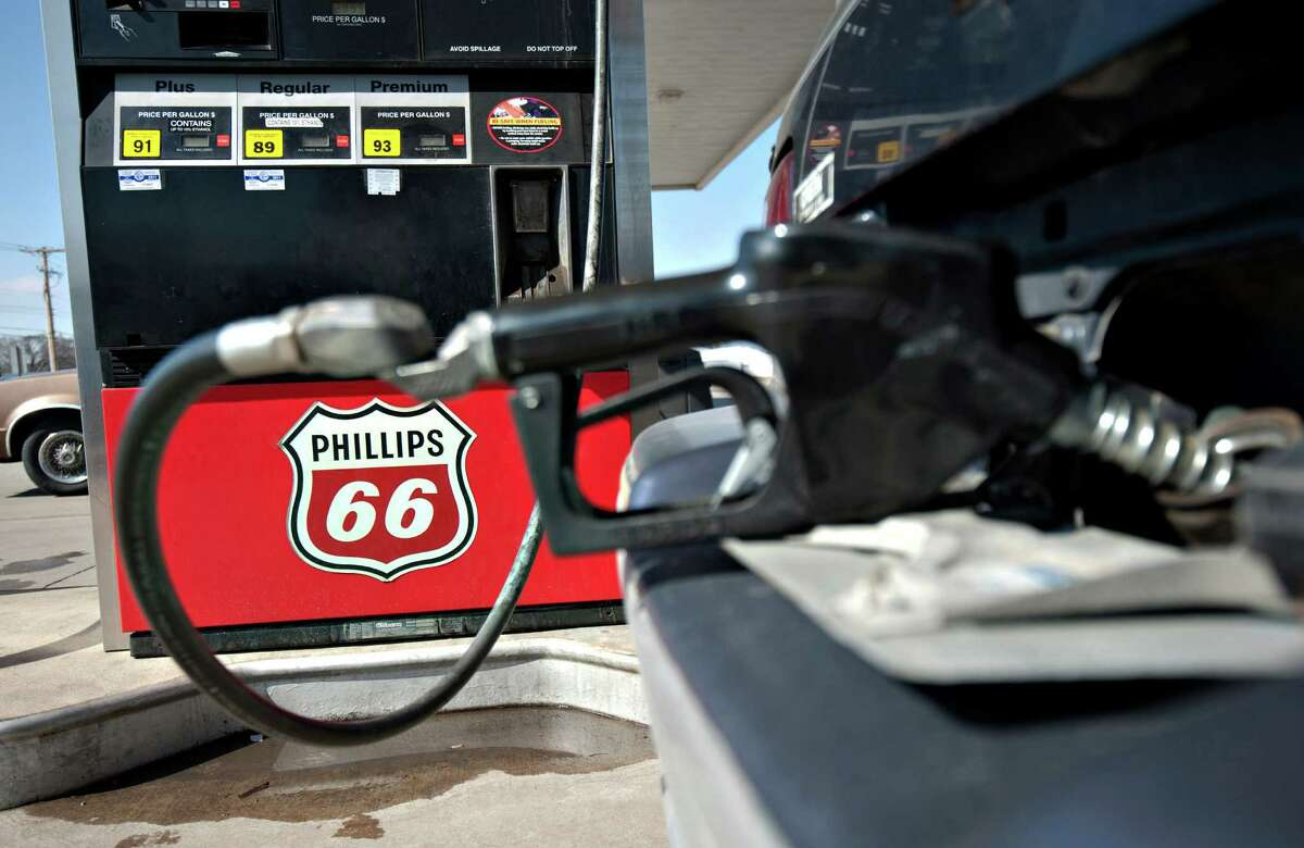 A Phillips 66 logo is seen on a gas pump as a car is filled a Beck's station in Princeton, Illinois. Photographer: Daniel Acker/Bloomberg