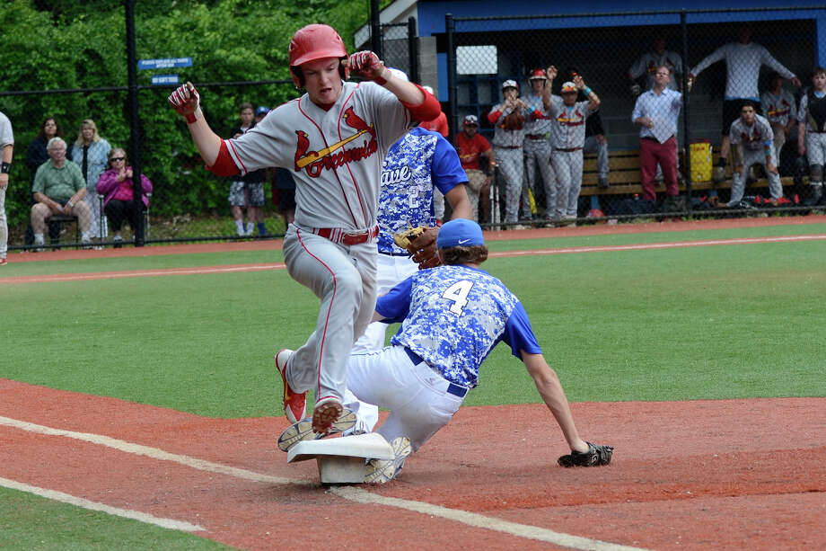 Darien first baseman Conor Davey beats Greenwich's Devin McGrath to first as Darien High School hosts Greenwich High School in Class LL varsity baseball in Darien, CT on June 4, 2015. Photo: Shelley Cryan / Stamford Advocate Freelance / Shelley Cryan