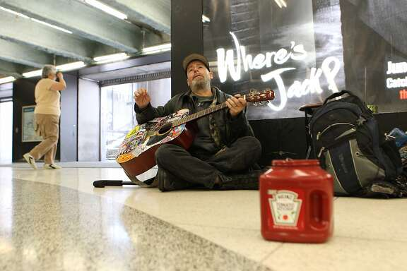 "Tim Lloyd plays an AC/DC song in hopes of donations from Bart passengers at the Powell Street Bart Station on Thursday, June 4, 2015. ""I played with some big names, but my alcoholism has really gotten the best of me,"" Lloyd said. He has terminal liver cancer."