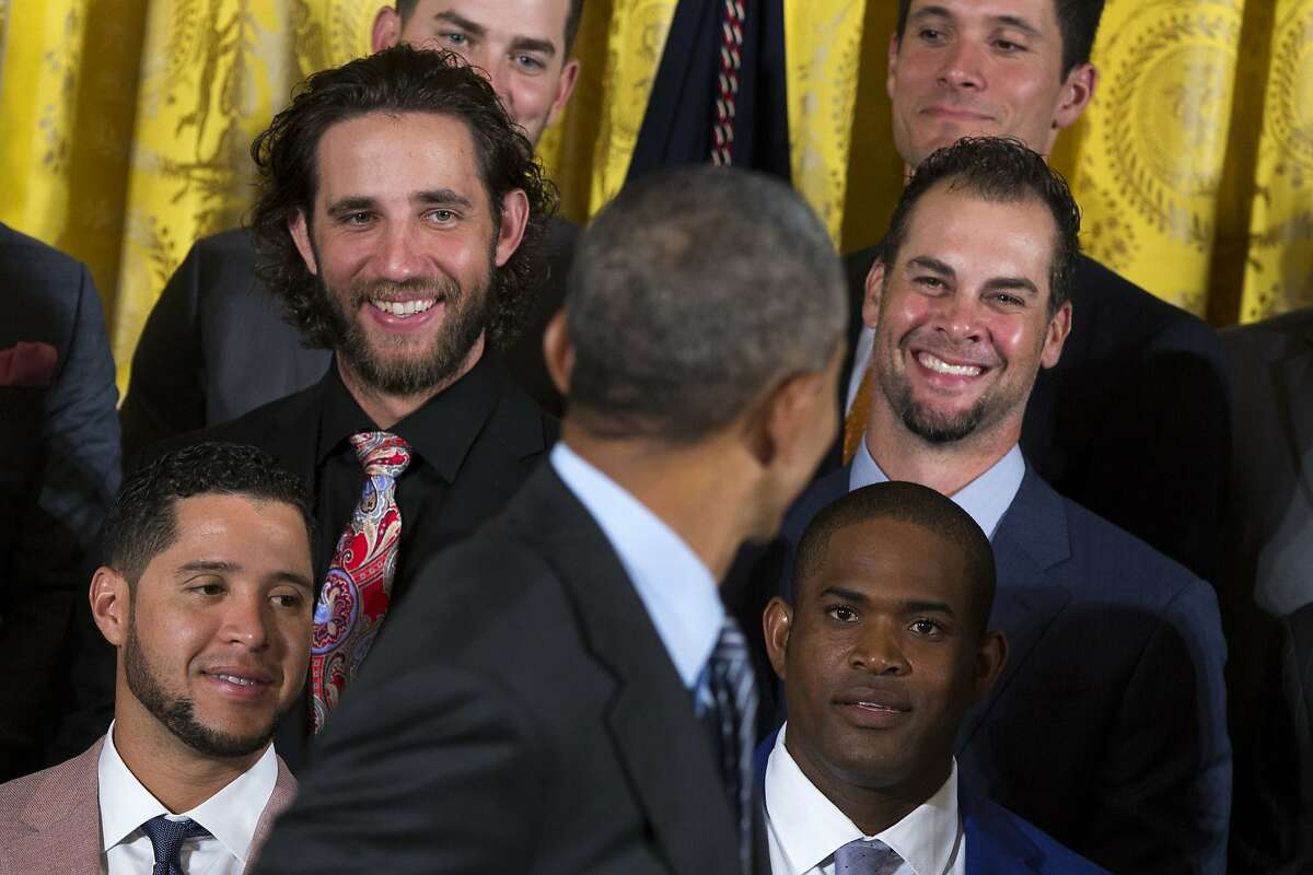 San Francisco Giants pitcher Madison Bumgarner, second from left, and pitcher Ryan Vogelsong, right, laugh as President Barack Obama welcomes the World Series champion Giants, Thursday, June 4, 2015, during a ceremony in the East Room of the White House in Washington. (AP Photo/Evan Vucci)