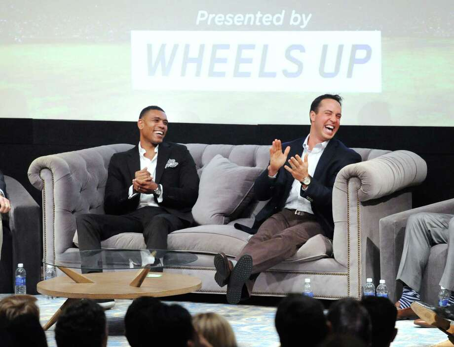 """Former New York Knick star Allan Houston, left, and New York Yankees first baseman Make Teixeira, right, both Greenwich residents, share a laugh while speaking about their favorite sports movies during the Greenwich International Film Festival panel """"Sports Guys on Sports Movies"""" event at Greenwich Library, Thursday night, June 4, 2015. Mike Greenberg of ESPN Radio led a panel discussion on sports movies with local sports heroes that included Houston and Teixeira. Photo: Bob Luckey / Greenwich Time"""